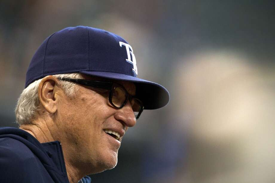 Rays manager Joe Maddon smiles during action against the Astros.