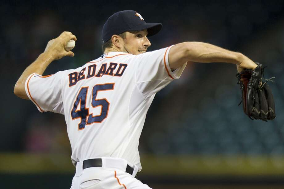Astros pitcher Erik Bedard delivers a throw to the Rays.