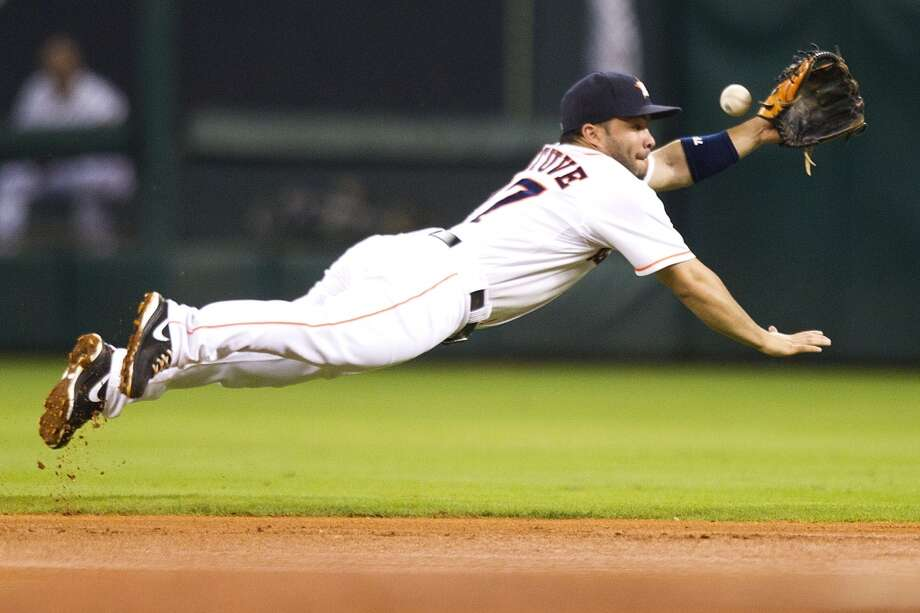 Astros second baseman Jose Altuve comes up empty as he dives for a ball during the fourth inning.