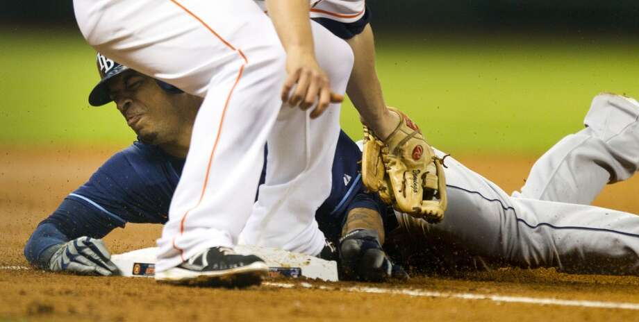 Rays center fielder Desmond Jennings slides under the tag of Astros third baseman Matt Dominguez as he steals third during the fourth inning.