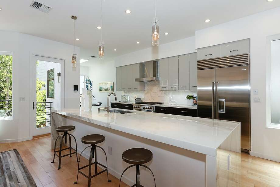 The kitchen has Calcutta Oro marble countertops and a professional Wolf range. Photo: Adam Willis