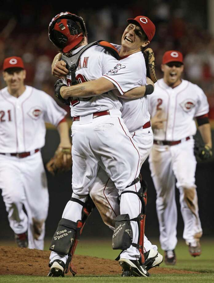 Reds pitcher Homer Bailey (right), a La Grange native, hugs catcher Ryan Hanigan after finishing off his second career no-hitter. The other came last September in Pittsburgh. Photo: Al Behrman / Associated Press