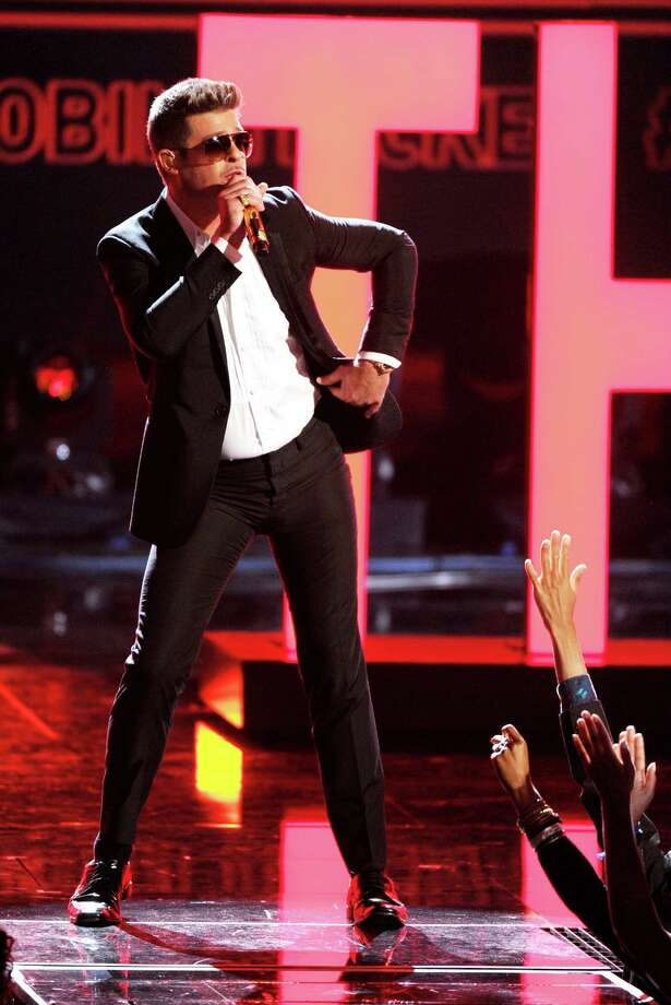 Robin Thicke performs at the BET Awards at the Nokia Theatre on Sunday, June 30, 2013, in Los Angeles. (Photo by Frank Micelotta/Invision/AP) ORG XMIT: NYET209 Photo: Frank Micelotta / Invision