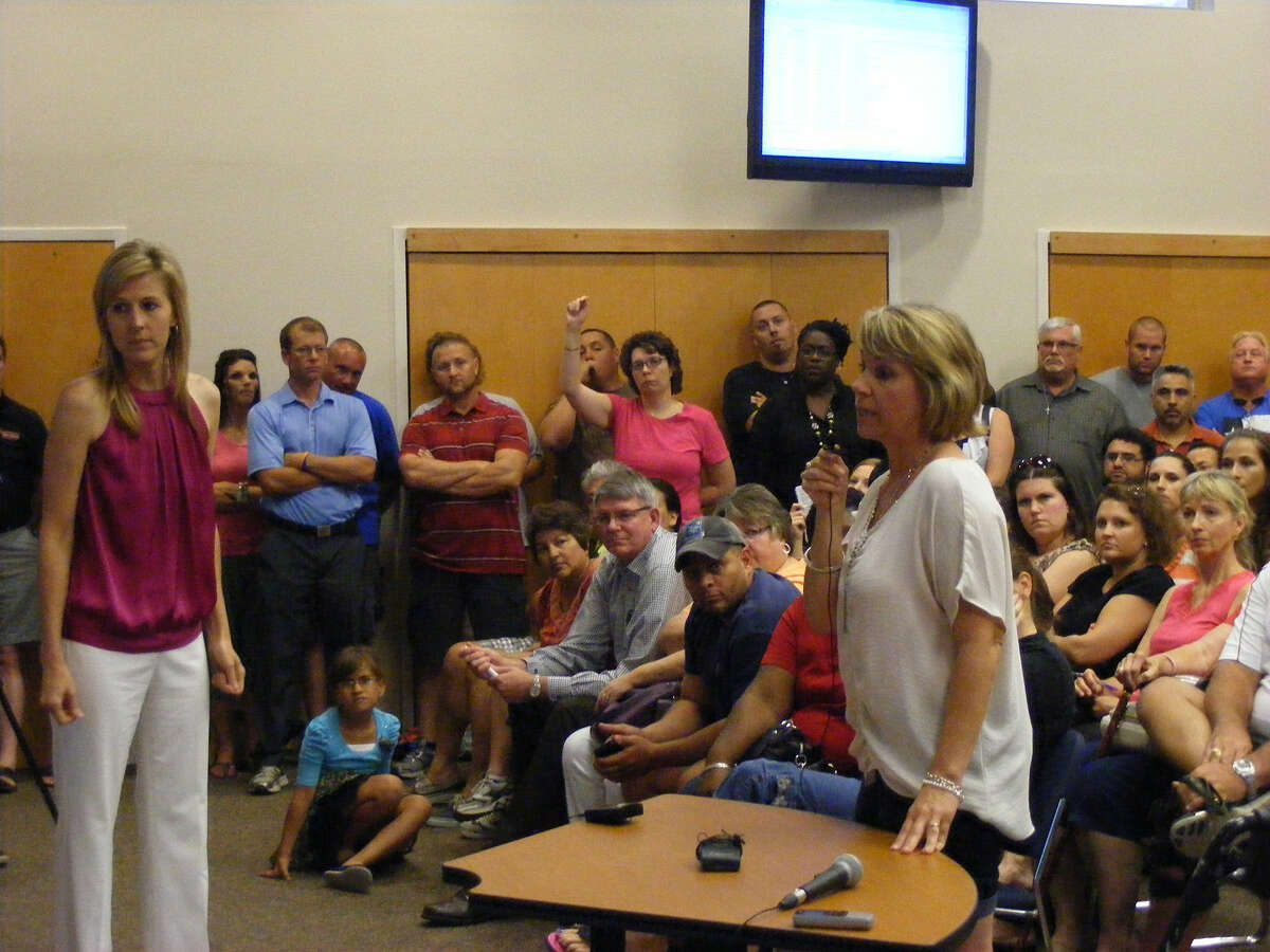 Lisa Jackson speaks during a town hall meeting by the Cibolo City Council concerning the possibility of Wal-Mart building a store in that community.