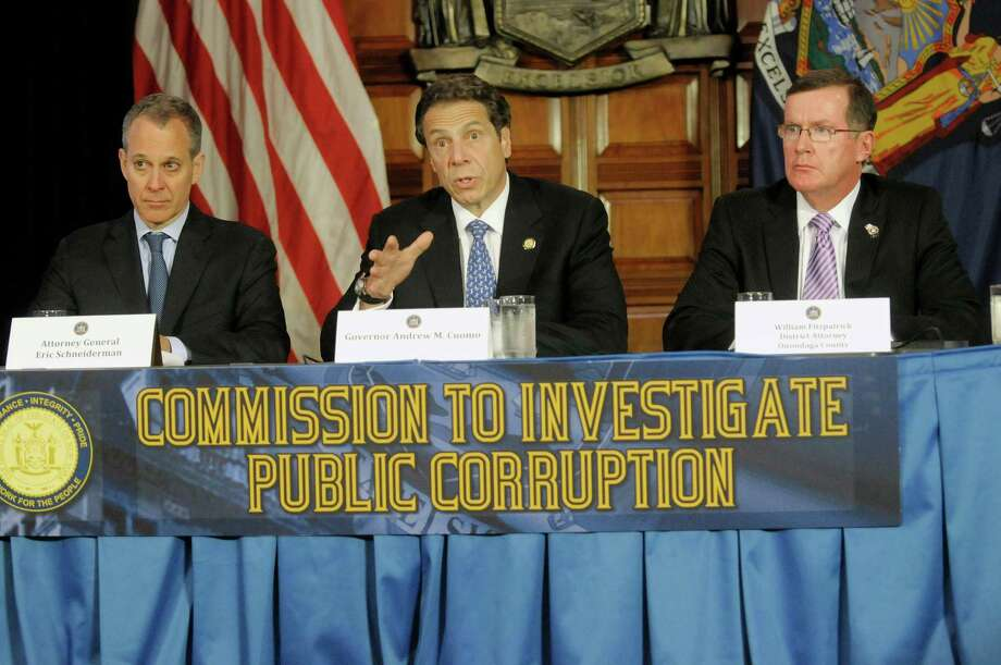 New York State Attorney General Eric Schneiderman, left, Governor Andrew Cuomo, center, and William Fitzpatrick, Onondaga County district attorney take part in a press conference at the Capitol on Tuesday, July 2, 2013, where Governor Cuomo introduced the members of the Moreland Commission that will investigate public corruption around the state.  (Paul Buckowski / Times Union) Photo: Paul Buckowski / 00023031A
