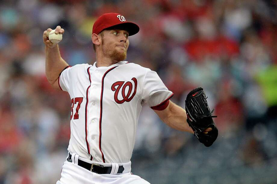 WASHINGTON, DC - JULY 02:  Starting pitcher Stephen Strasburg #37 of the Washington Nationals throws a pitch in the second inning during a game against the Milwaukee Brewers at Nationals Park on July 2, 2013 in Washington, DC.  (Photo by Patrick McDermott/Getty Images) ORG XMIT: 163494372 Photo: Patrick McDermott / 2013 Getty Images