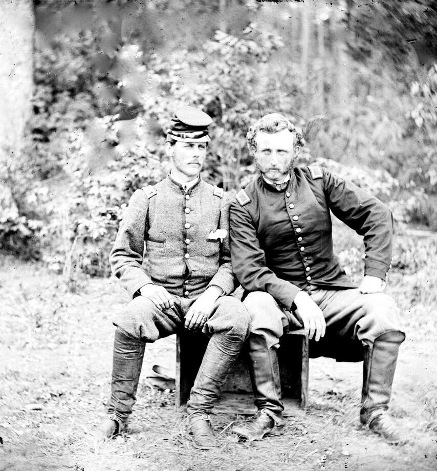 Captain George Armstrong Custer (right) of the 5th Cavalry sits with a Confederate prisoner, Lieutenant James B Washington, in Fair Oaks, VA, 1862. (Photo by James F. Gibson/Buyenlarge/Getty Images) Photo: Buyenlarge, Getty Images / Archive Photos