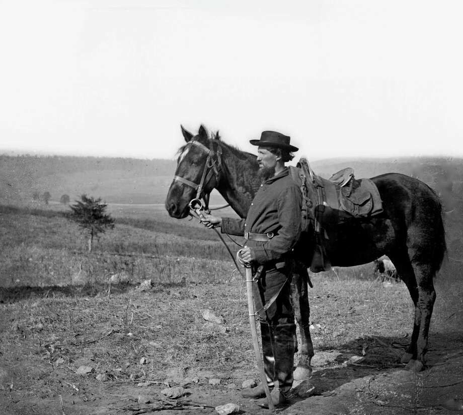 A cavalry orderly stands with a horse, Antietam, MD, 1862. (Photo by Alexander Gardner/Buyenlarge/Getty Images) Photo: Buyenlarge, Getty Images / Archive Photos