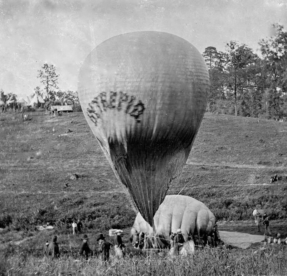 Professor Thaddeus S Lowe inflating the balloon Intrepid with air taken from the balloon Constitution, in order to provide a vantage point for the coming Battle of Fair Oaks, VA, 1862. Photo: Buyenlarge, Getty Images / Archive Photos