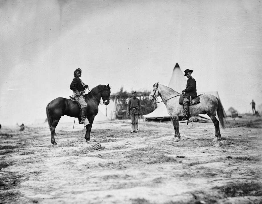 George A. Custer (1839 - 1876), then a Captain, on horseback, left, and facing General Alfred Pleasanton (1824 - 1897) , Falmouth, VA, 1863. Pleasanton, a cavalry general during the American Civil War, promoted Custer to the rank of Brigadier General. (Photo by Timothy H. O'Sullivan/Interim Archives/Getty Images) Photo: Interim Archives, Getty Images / Archive Photos