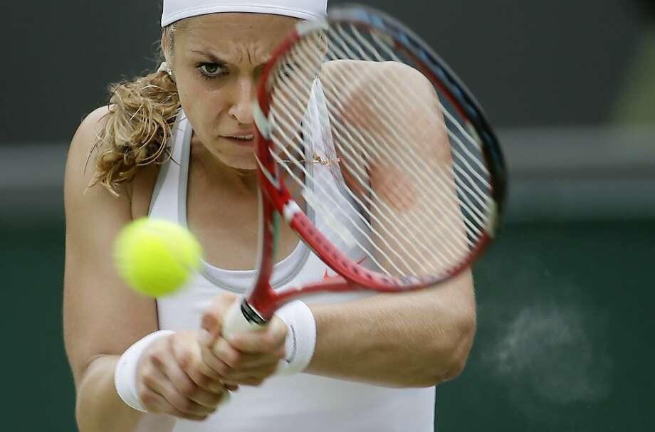 Sabine Lisicki of Germany plays a return to Kaia Kanepi of Estonia in a Women's singles quarterfinal match at the All England Lawn Tennis Championships in Wimbledon, London, Tuesday, July 2, 2013. (AP Photo/Alastair Grant) Photo: Alastair Grant, Associated Press
