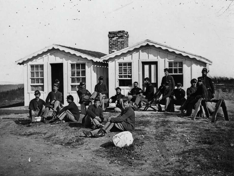circa 1860s:  Union Officers of the 119th PA relaxing outside their quarters. Photo: MPI, Getty Images / Archive Photos