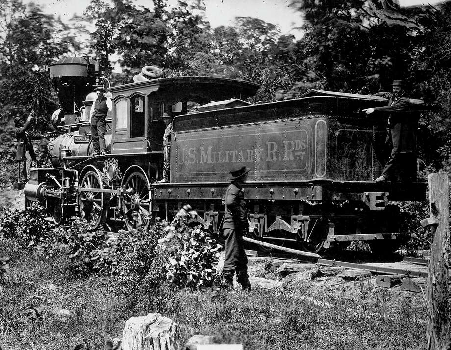 Railroad officials pointing to holes left by Confederate gunshot in engine & tender of Federal military train, during Civil War.  (Photo by Time Life Pictures/National Archives/Time Life Pictures/Getty Images) Photo: Time Life Pictures, Time & Life Pictures/Getty Image / Time Life Pictures