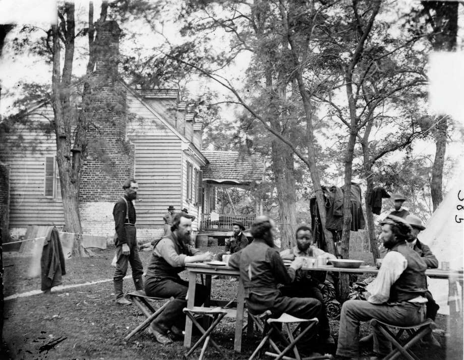 Allan Pinkerton (1819 - 1884), Scottish-born founder of the Pinkerton National Detective Agency, with some of his agents, circa 1862. Pinkerton served as head of the Union Intelligence Service during the American Civil War and foiled a plot to assassinate Abraham Lincoln. Photo: MPI/Hulton Archive, Getty Images / 2006 Getty Images
