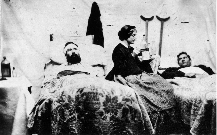 A nurse prepares to spoon-feed soldiers in this photograph taken by Jim Enos inside the Union hospital at Carlisle Barracks, Pennsylvania, USA, circa 1861. Photo: Fotosearch, Getty Images / 2010 Getty Images