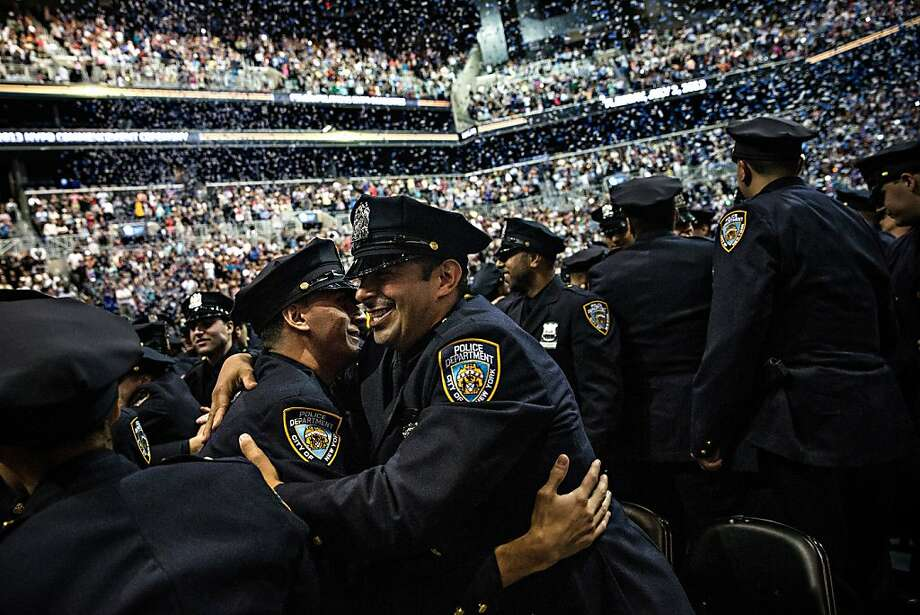 NEW YORK, NY - JULY 02:  New York City Police Academy cadets celebrate after their graduation ceremony at the Barclays Center on July 2, 2013 in the Brooklyn borough of New York City. The New York Police Department (NYPD) has more than 37,000 officers; 781 cadets graduated today.  (Photo by Andrew Burton/Getty Images) Photo: Andrew Burton, Getty Images