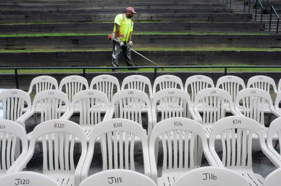 City of Albany Department of Parks employee, Bobby Brown, cuts the grass on the step seating in Washington Park on Tuesday, July 2, 2013 in Albany, NY.  The chairs are set up for the Albany Park Playhouse.  (Paul Buckowski / Times Union) Photo: Paul Buckowski