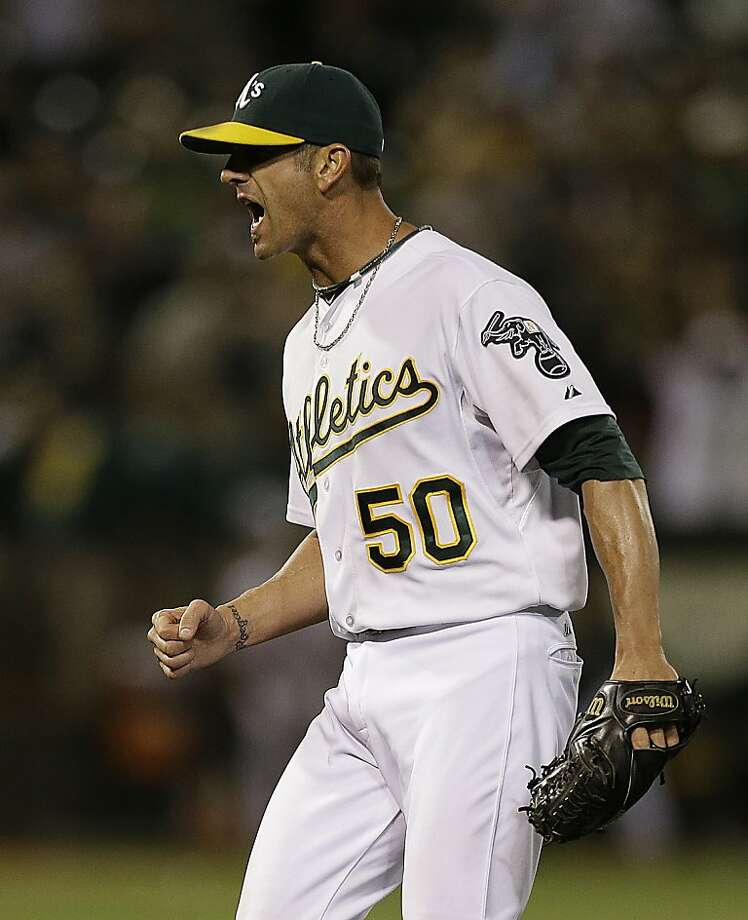 Oakland Athletics' Grant Balfour reacts after the final out is made against the Chicago Cubs at the end of a baseball game Tuesday, July 2, 2013, in Oakland, Calif. (AP Photo/Ben Margot) Photo: Ben Margot, Associated Press
