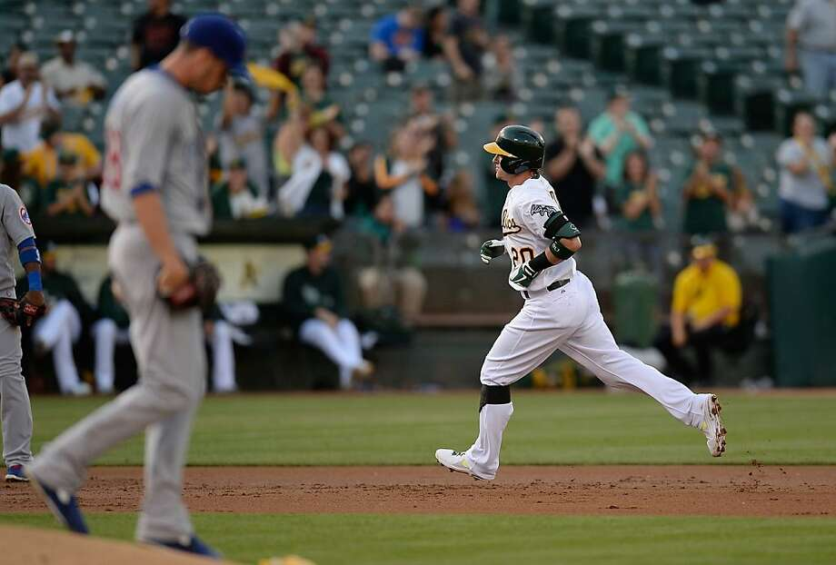 OAKLAND, CA - JULY 02:  Josh Donaldson #20 of the Oakland Athletics trots around the bases after hitting a two-run homer as pitcher Chris Rusin #18 of the Chicago Cubs looks on in the first inning at O.co Coliseum on July 2, 2013 in Oakland, California.  (Photo by Thearon W. Henderson/Getty Images) Photo: Thearon W. Henderson, Getty Images
