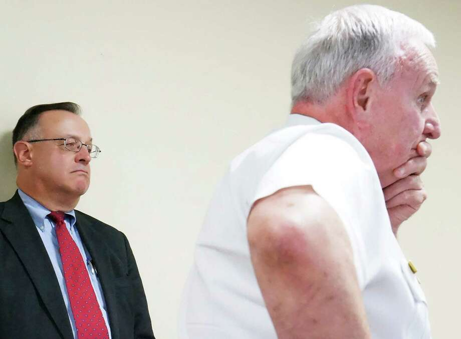 Fire Chief Richard Felner, foreground, and Alex Trembicki, the lawyer who investigated controversial Fire Department promotions last year, discuss the probe's findings with the Board of Selectmen on Tuesday. Photo: Genevieve Reilly / Fairfield Citizen