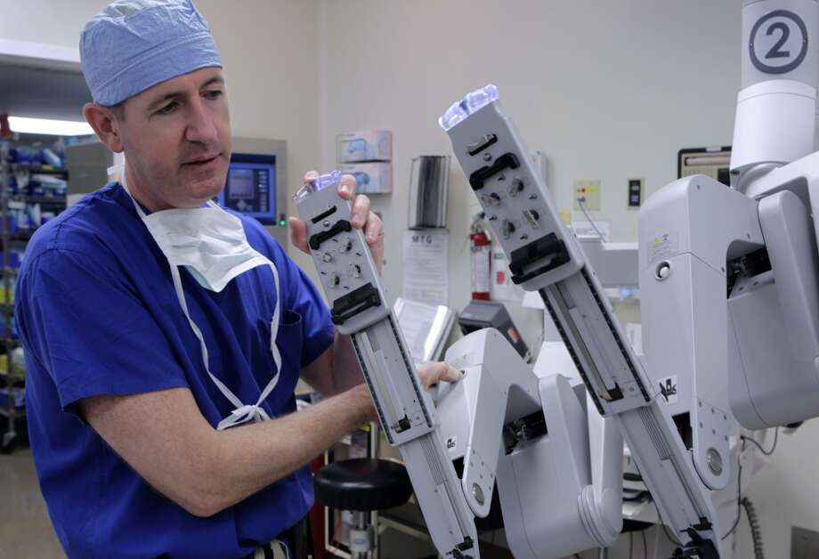 Dr. Ed Damrose prepares the DaVinci surgical robot for a transoral operation at Stanford Medical Center in Stanford, Calif. on Friday, June 28, 2013.