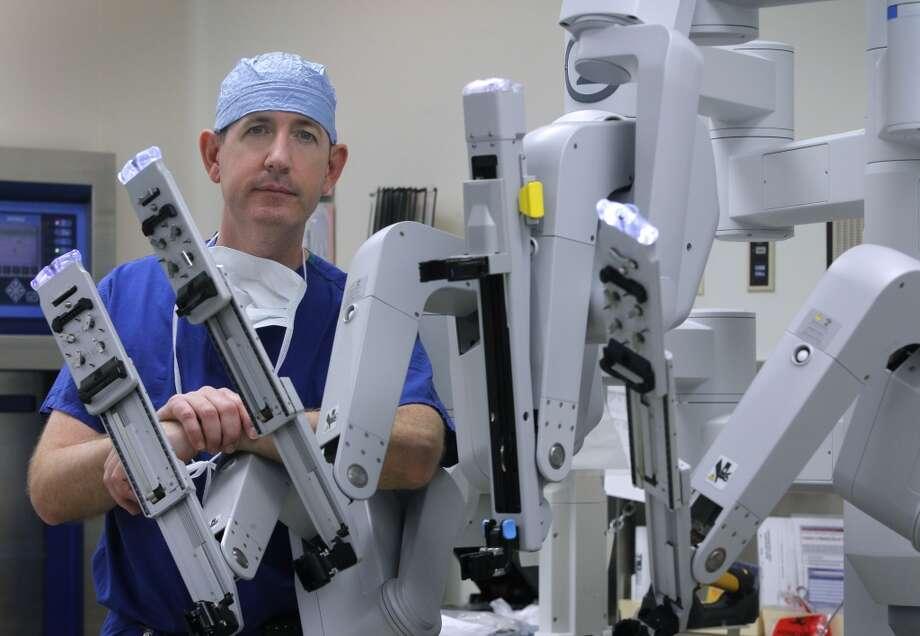 Dr. Ed Damrose prepares the DaVinci surgical robot for a transoral operation at Stanford Medical Center in Stanford, Calif. on Friday, June 28, 2013.