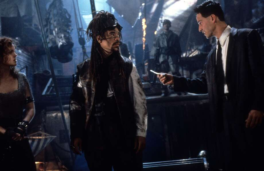 Johnny Mnemonic  This time Keanu Reeves isn't a human slave to computers in a virtual world. Instead, he's a human with a computer in his brain who works as a courier of sensitive information. Panned by critics, Johnny was a box office bomb, and has become the kind of archetype of unloved silly scifi thrillers.
