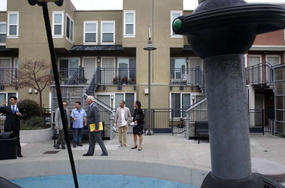 The group touring North Beach Place in San Francisco, Ca. on Wednesday Mar. 27, 2013. AS San Francisco Mayor Ed Lee is moving to remake the troubled city's Housing Authority as administrator Naomi Kelly along with her colleagues tour several housing projects around the city to see what changes need to be made. Photo: Michael Macor, The Chronicle