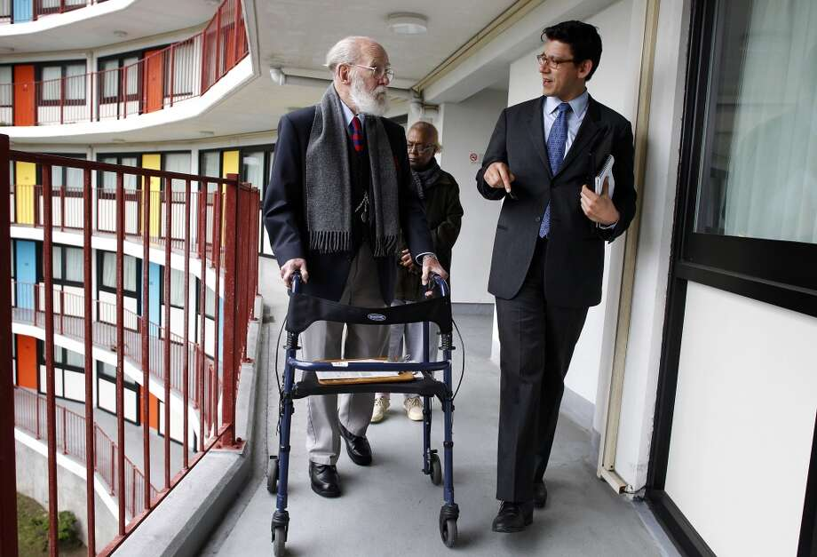 Joaquin Torres, (right) the president of the Board of Commissioners, San Francisco Housing Authority meets with fifteen year resident John Gaul and fourteen year resident Carolyn Douglas as they tour the JFK Towers in San Francisco, Ca. on Wednesday Mar. 27, 2013. San Francisco Mayor Ed Lee is moving to remake the troubled city's Housing Authority administrator Naomi Kelly along with her colleagues tour several housing projects around the city to see what changes need to be made. Photo: Michael Macor, The Chronicle