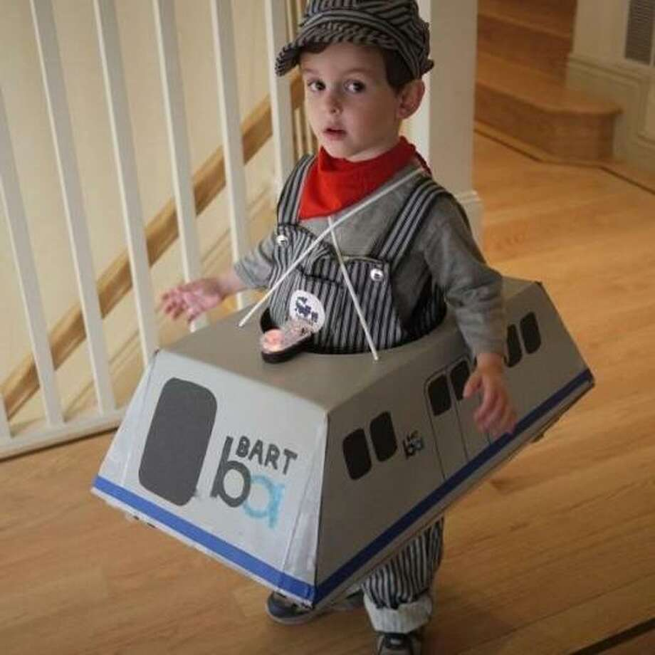 A wee BART train from our 2012 costume contest. The conductor's uniform is an excellent touch. When the strike is over, BART should adopt this look for its drivers.