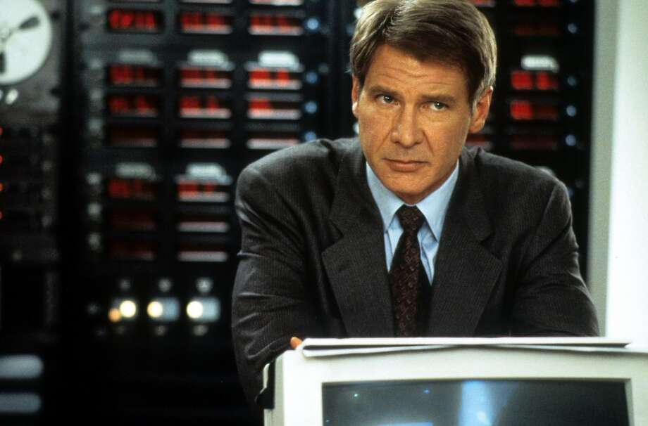 Clear and Present Danger  Harrison Ford had already been laying out Nazis with his bare hands and tearing through Imperial TIE fighters when he reprised his role as CIA agent Jack Ryan in 1994. In a film series full of shootouts and terrorist attacks, somehow the most memorable sequence involved two men in separate rooms typing madly at low-res white-one-blue screens—hacking within a closed network with the security of the United States at stake.