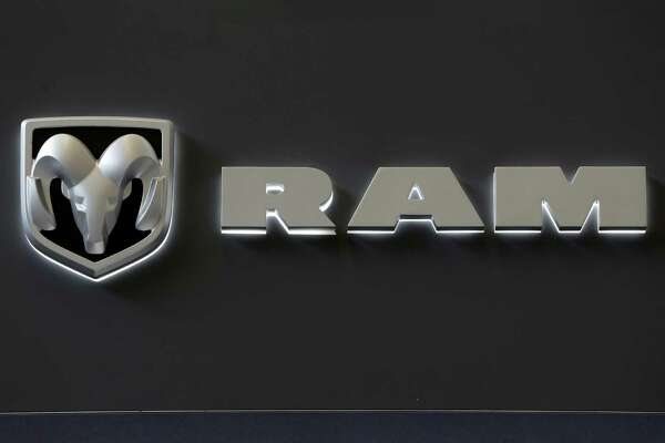 In this Feb. 14, 2013 photo, the Dodge Ram truck logo appears on a sign at the 2013 Pittsburgh Auto Show in Pittsburgh. Sales from the major automakers are expected to show that confident U.S. buyers snapped up new cars and trucks at a strong pace in June. Chrysler said Tuesday, July 2, 2013, that its sales rose 8 percent for its best June since 2007. Ram brand sales rose 23 percent and Dodge sales were up 12 percent on the strength of the Dodge Dart small car.