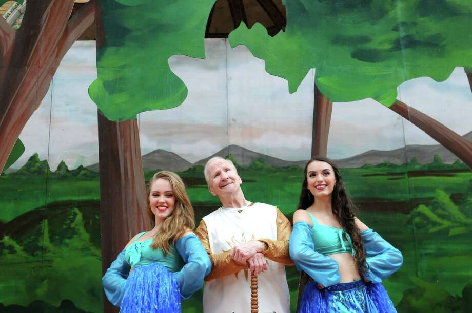 "Steven Earl-Edwards, center, who plays King Arthur, with cast members Nicolette Burton, left, and Celeste Hudson, right, pose for photos in the Park Playhouse production of ""Spamalot,"" Friday June 28, 2013, at the Park Playhouse in Albany, N.Y. (Ben Goldman/Special to the Times Union) Photo: Will Waldron / 00022898A"