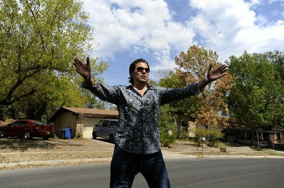 Armando Montelongo shows off an investment property in San Antonio in 2011.