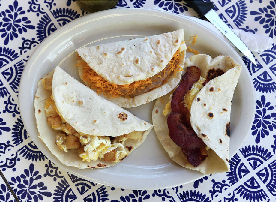 Nov. 13, 2013 - Eggs and potatoes, chorizo, bean and cheese, or chiliquiles - all wrapped in the loving embrace of a fluffy flour tortilla. Yes,there are an endless number of combinations that make this San Antonio breakfast staple, the humble but oh-so-good breakfast taco. And we are thankful for them all. Photo: JERRY LARA, San Antonio Express-News / © 2013 San Antonio Express-News