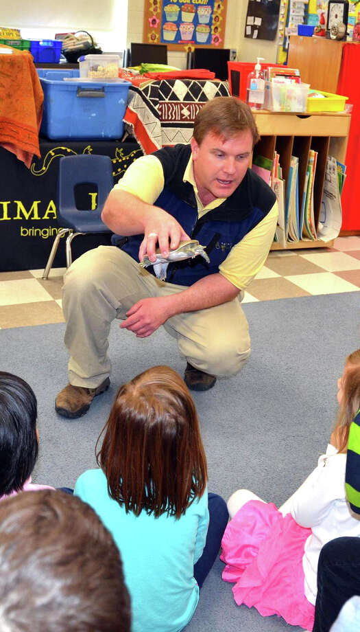Chris Evers, director and founder of Stamford-based Animal Embassy speaks before a group of children as part of the organization's educational programming. Animal Embassy will present a free program from 6 to 7 p.m., Saturday, July 13, at the Sherwood Island Nature Center at Sherwood Island State Park in Westport. It is a free program. For more information, visit http://theanimalembassy.ning.com, http://friendsofsherwoodisland.org. Photo: Contributed Photo