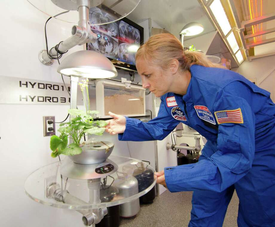 Kristin Bivona, a science teacher at Dolan Middle School, works in a simulator of the International Space Station as part of a space academy program funded by Honeywell at the U.S. Space & Rocket Center in Huntsville, Ala. Photo: Contributed Photo