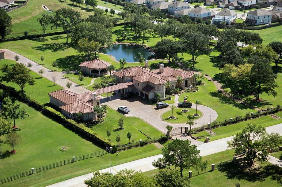 This pristine and serene Mediterranean-style estate sits on 4 acres.