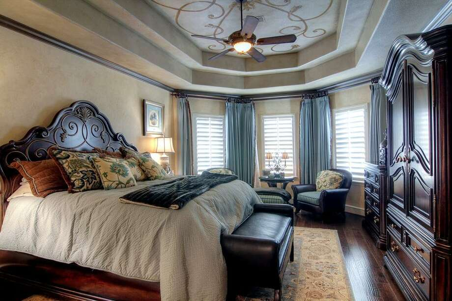 One of home's three upstairs bedrooms is spacious enoughfor a seating area and other furniture.