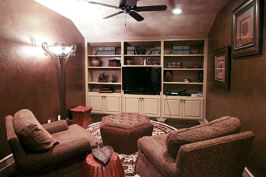 The upstairs game and media room provides a second,cozier option for entertaining.