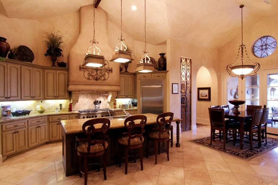 The open gourmet kitchen includes an eat-in area.