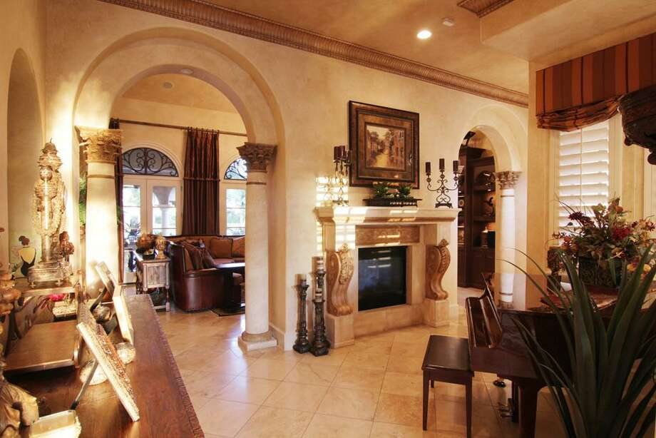 Travertine flooring is found in the entry way andthroughout the home.