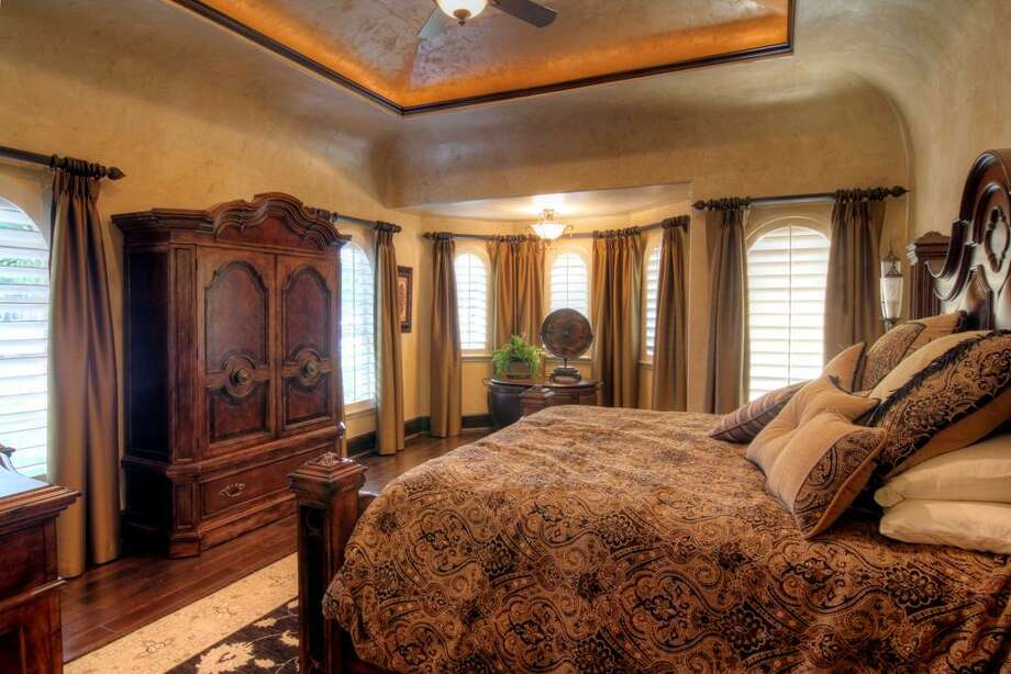 The spacious master bedroom in the guest house has enoughroom for furniture and has windows for plenty of natural light.
