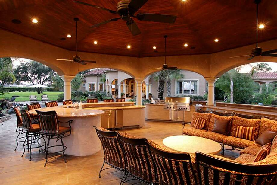 The outdoor kitchen and entertainment area features abuilt-in TV, gas grill, refrigerator and more.