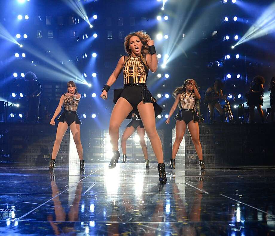 "Beyoncé brings ""The Mrs. Carter Show"" to HP Pavilion in San Jose, a two-hour performance of high-energy dancing and singing and big-budget scenery. The singer warned the crowd: ""This is not a show to sit down. This is a show to stand up, bounce, act like a child, get lost and have fun."" Photo: Kevin Mazur, WireImage For Parkwood Entertain"