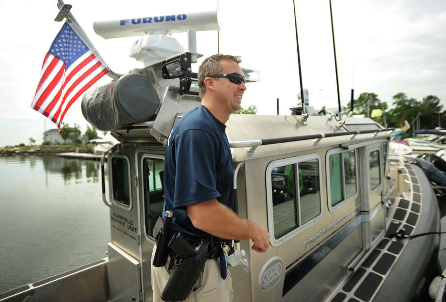 Fairfield Police Marine Unit Officer Jim Wiltsie prepares to embark on a patrol on the unit's state-of-the-art police boat from South Benson Marina in Fairfield, Conn. on Wednesday, July 3, 2013. Wiltsie said the days surrounding the July 4 holiday, because of the many fireworks displays on the Sound, are the units busiest of the year. Photo: Brian A. Pounds / Connecticut Post