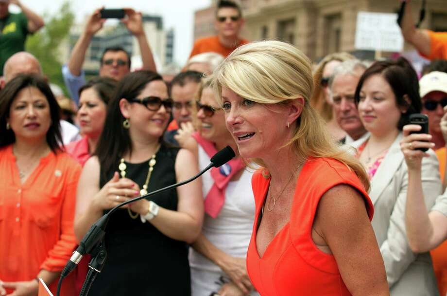 State Sen. Wendy Davis, D-Fort Worth, speaks at an abortion rights rally last week. A reader says Texans need more people like Davis to stand up for women's rights. Photo: Jay Janner, Associated Press / Austin American-Statesman