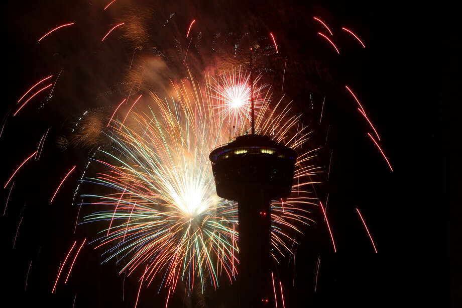 Fireworks burst next to the Tower of the Americas on July 4 last year during the Stars & Stripes Over San Antonio event.