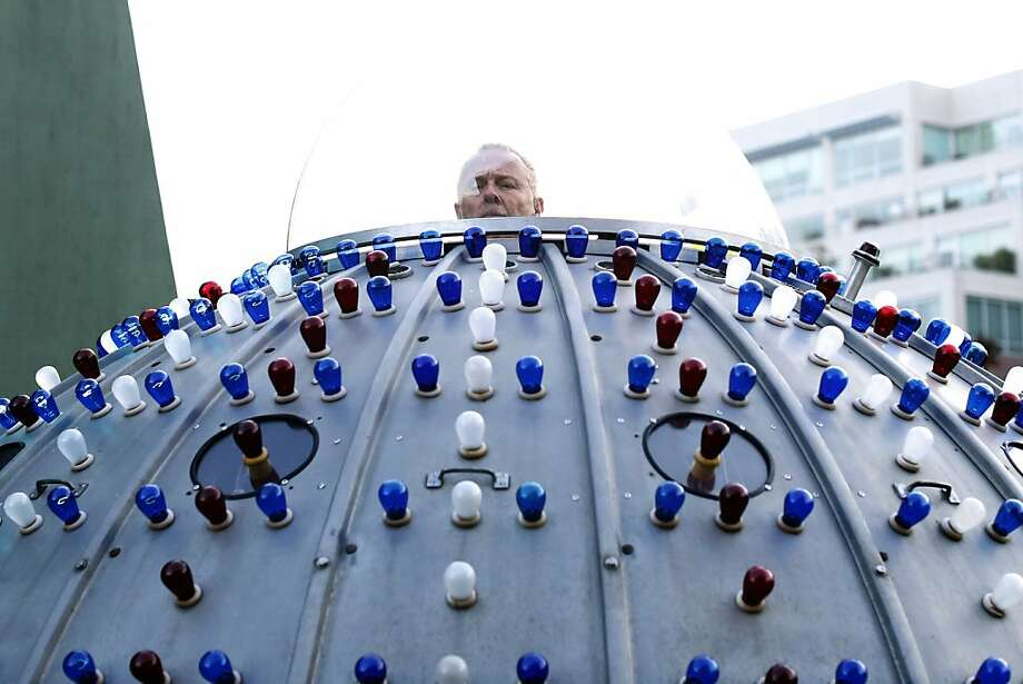 Eric Staller, a San Francisco artist, steers his Bubbleboat, which is decorated with 594 lights, from a clear glass bubble on top. Photo: Ian C. Bates, The Chronicle