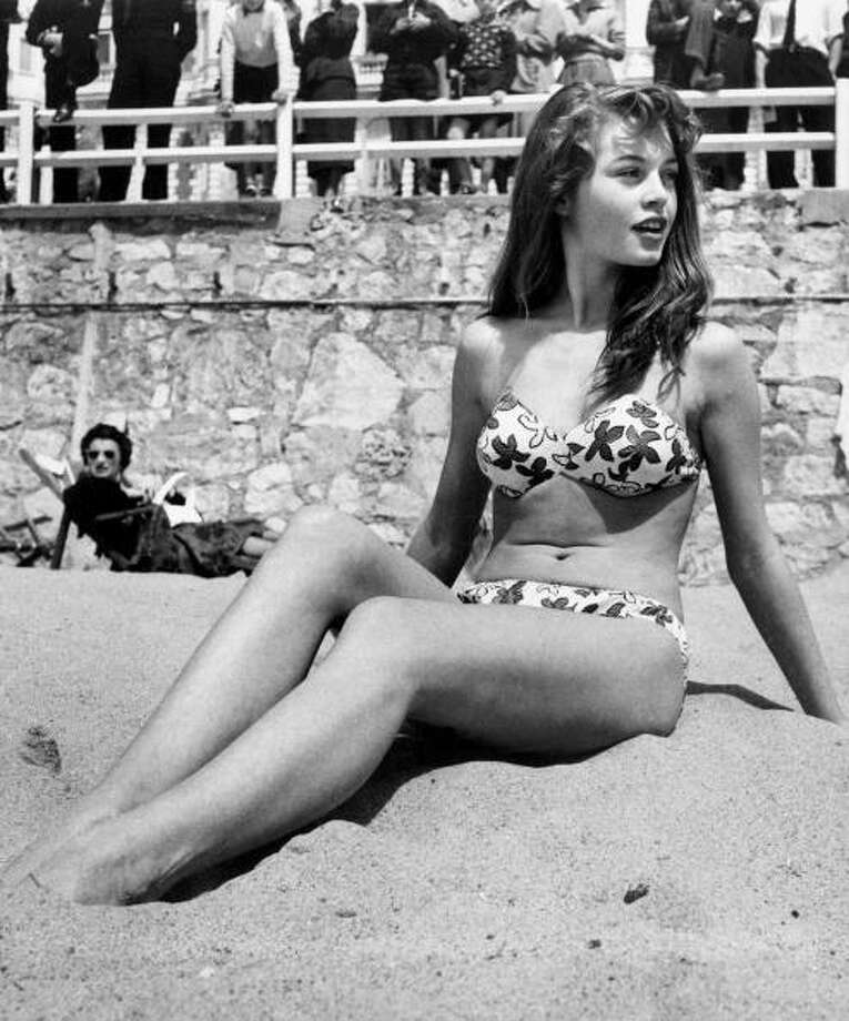 1953: French actress Brigitte Bardot sitting on the beach during the Cannes Film Festival Photo: RDA, Getty Images / 2007 Getty Images